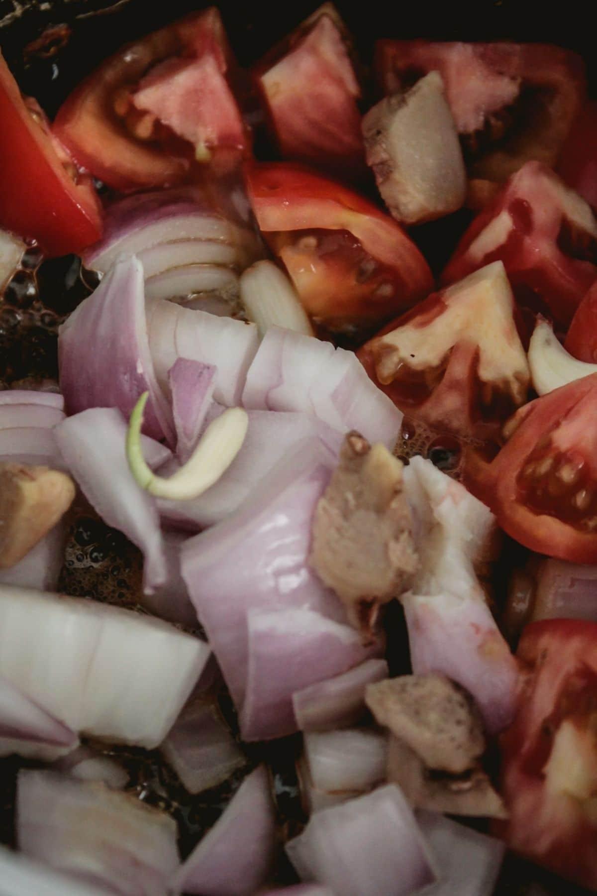 Adding vegetables into skillet