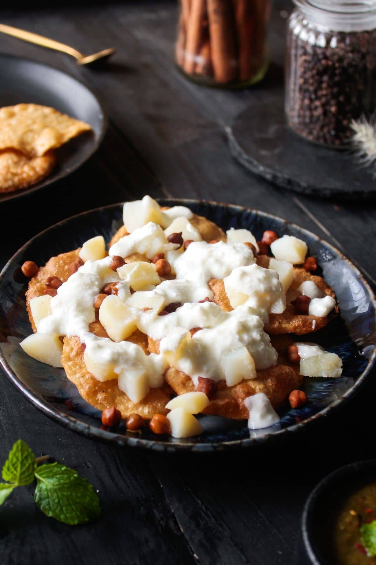 Topping papdi chaat with curd