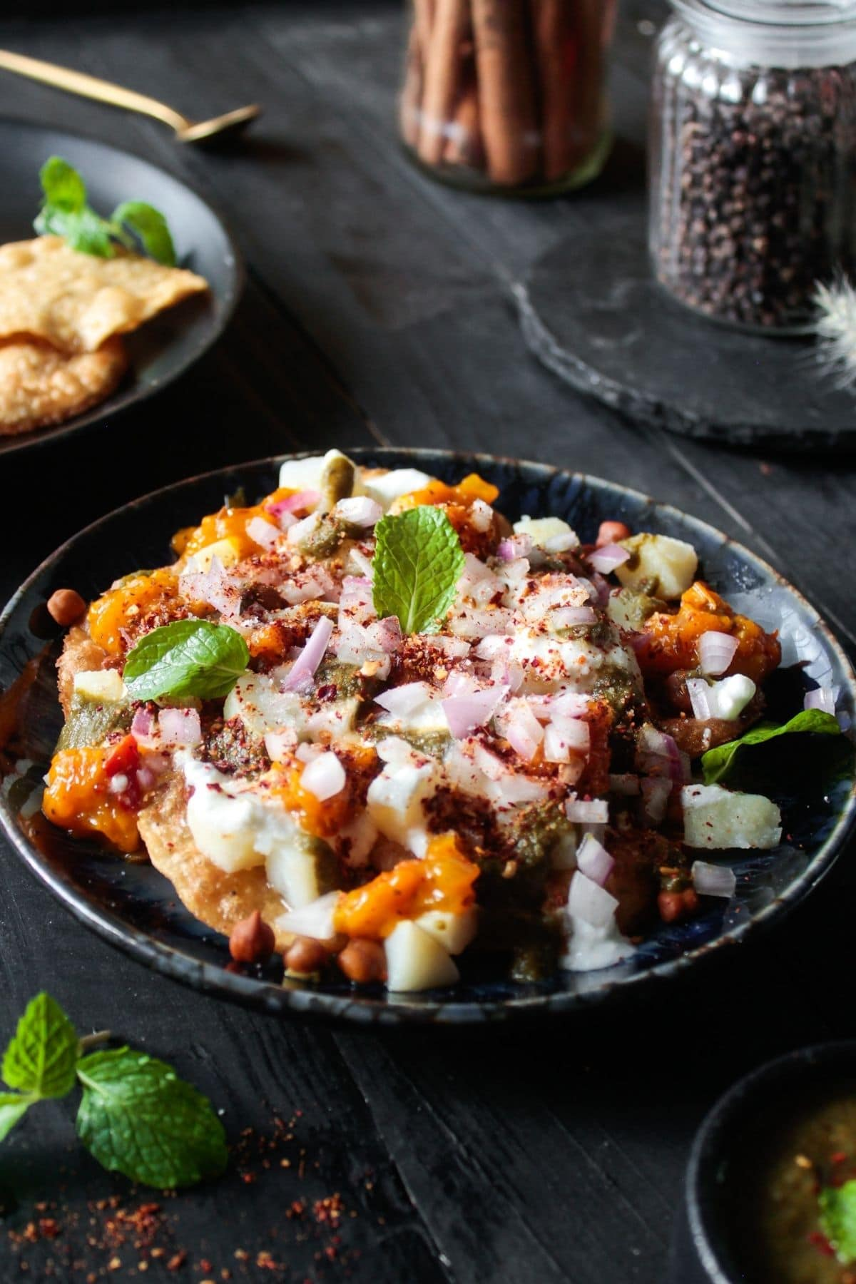Topping papdias with mint leaves