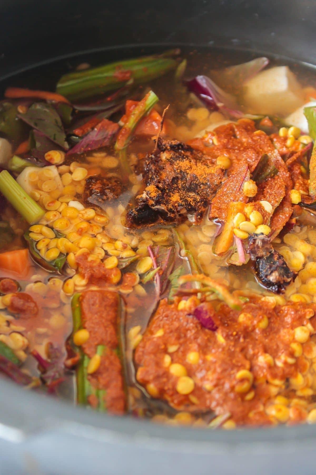 Adding tempering liquid to sambar