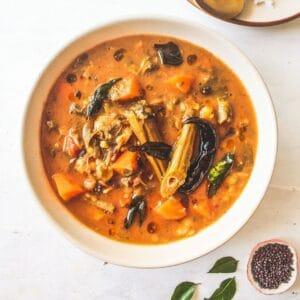 White bowl filled with sambar stew