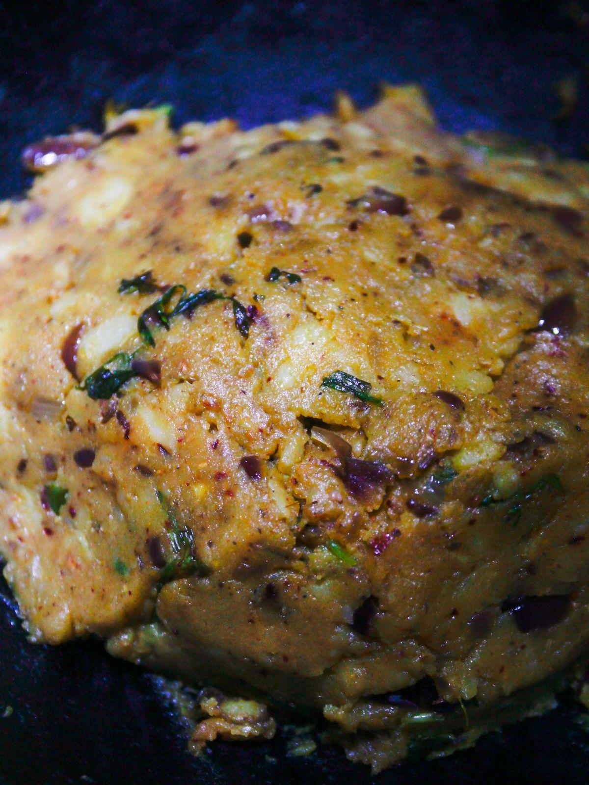 Seasoned mashed potatoes browning in skillet