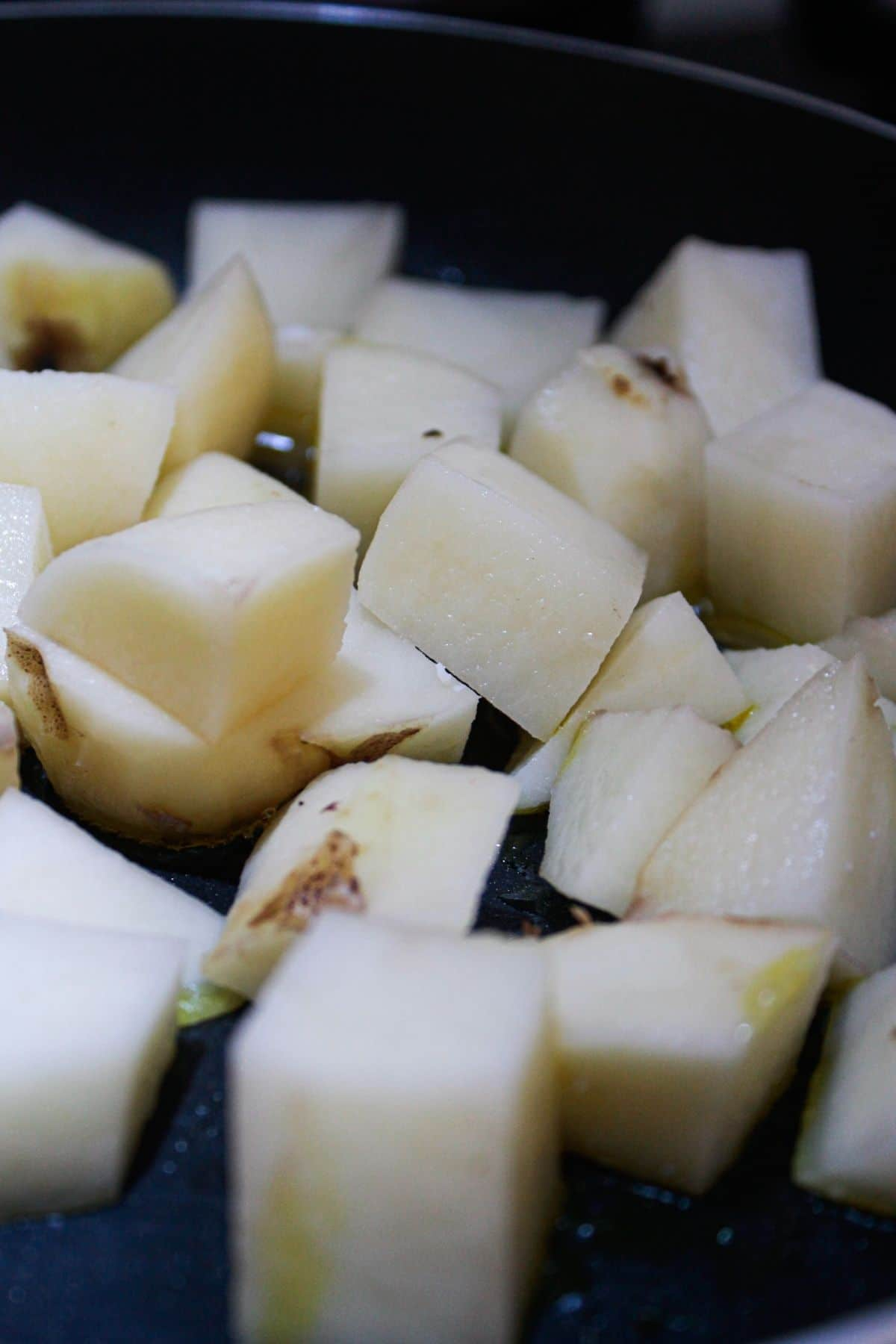 Diced potatoes in skillet