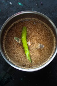 Poppy seeds and chile in chutney grinder