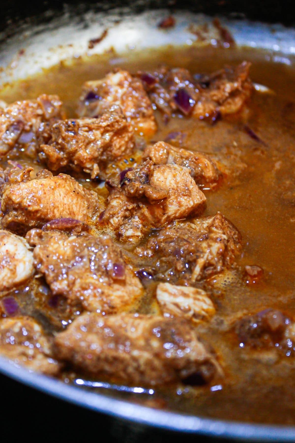 Chicken in vindaloo sauce in large skillet