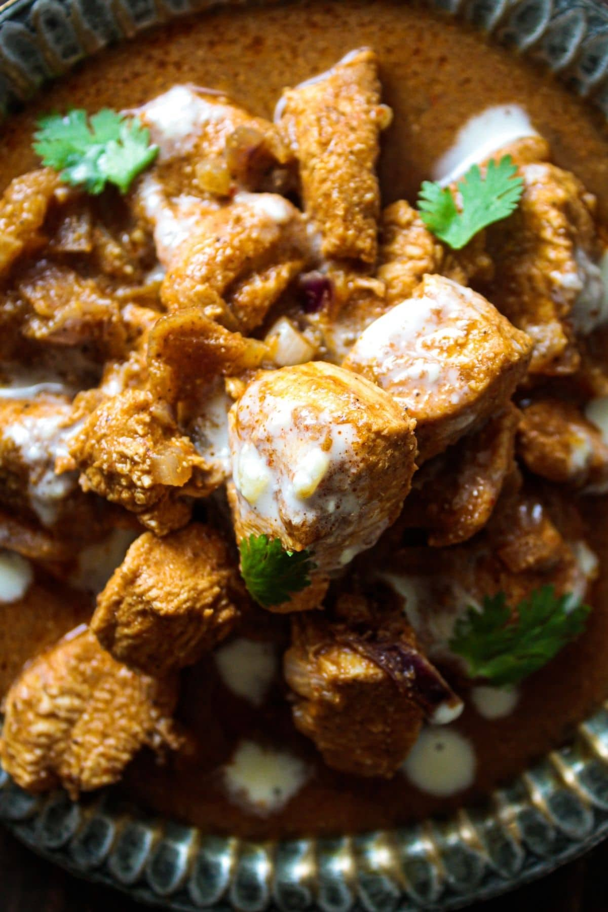 Close up image of chicken vindaloo with cream on top