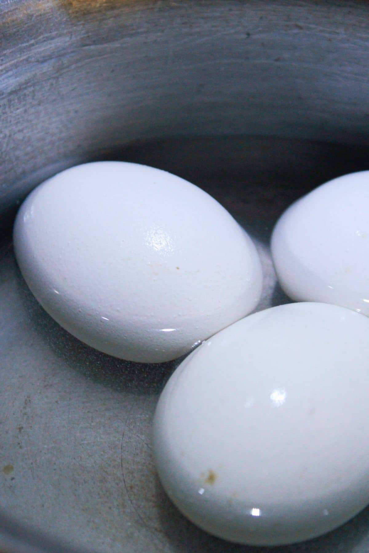 Eggs in saucepan with water