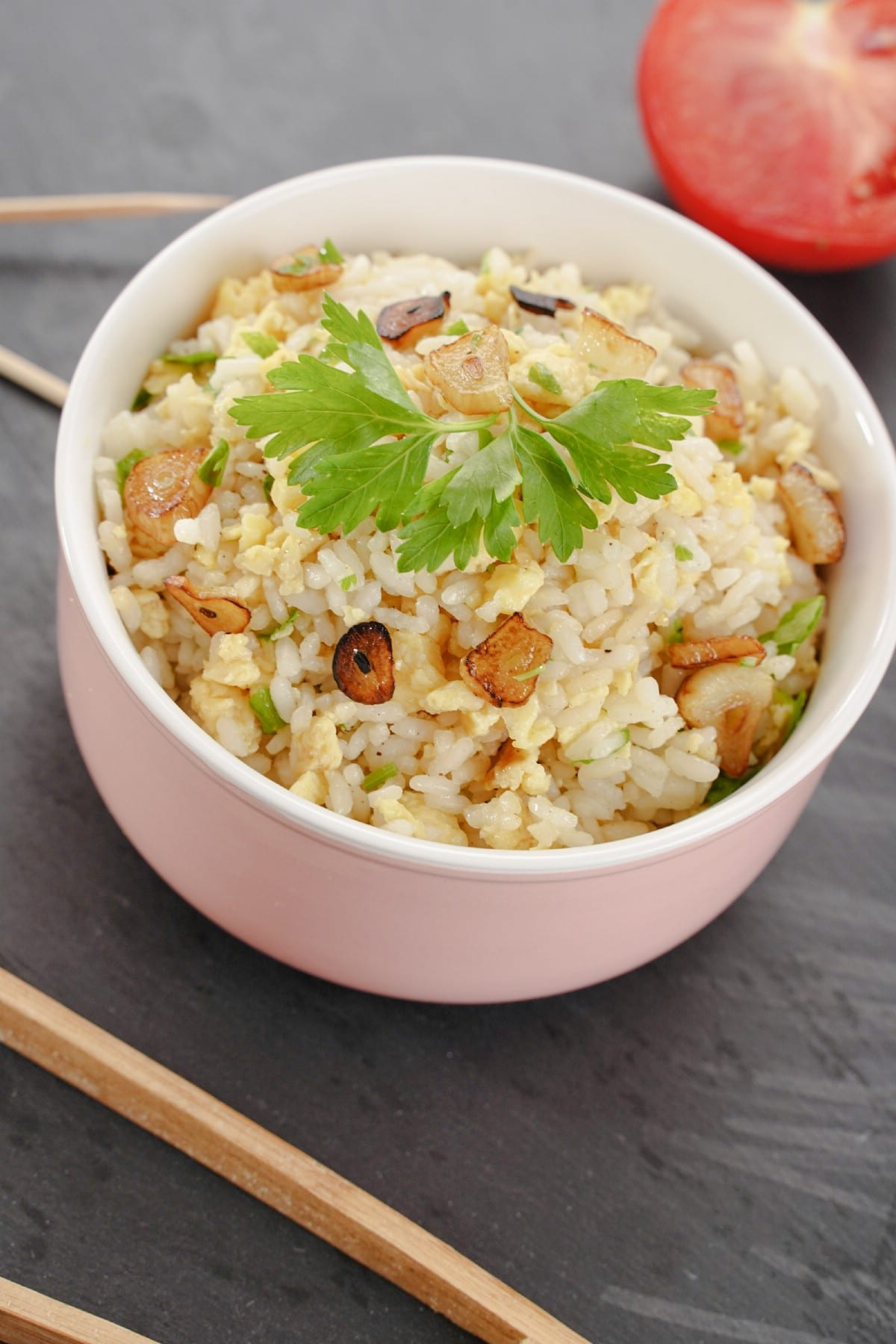 Large white bowl of rice on gray table