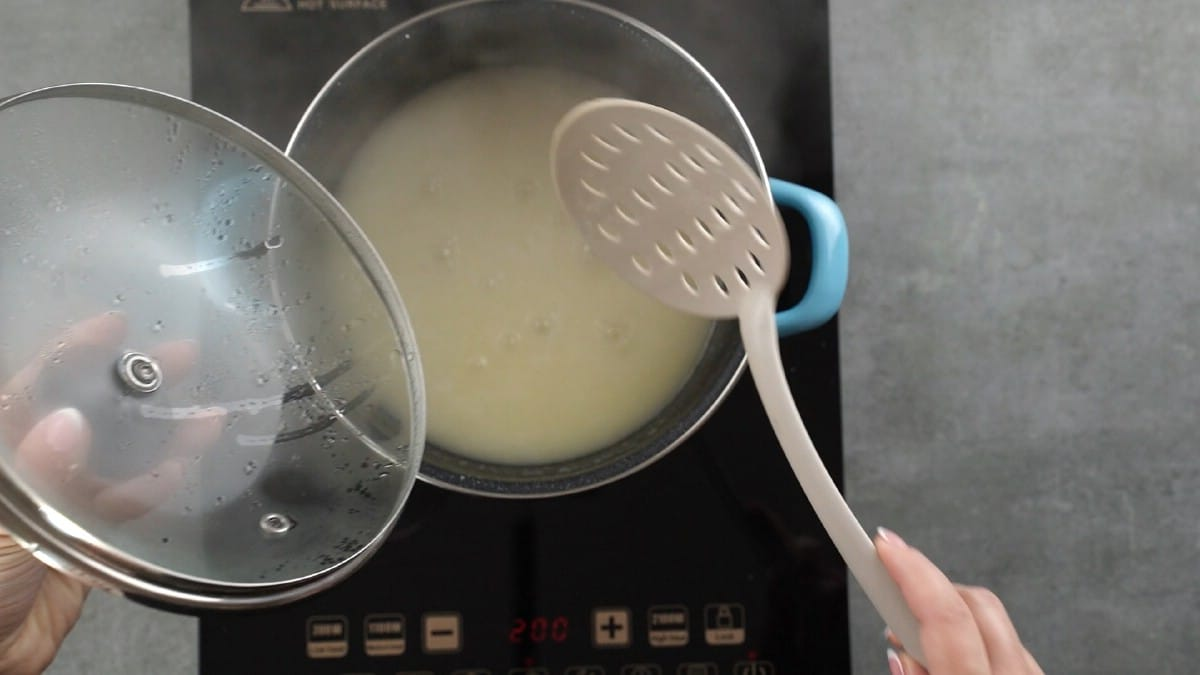 Lid off pot of rice on hot plate