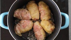 Cabbage rolls in bottom of saucepan