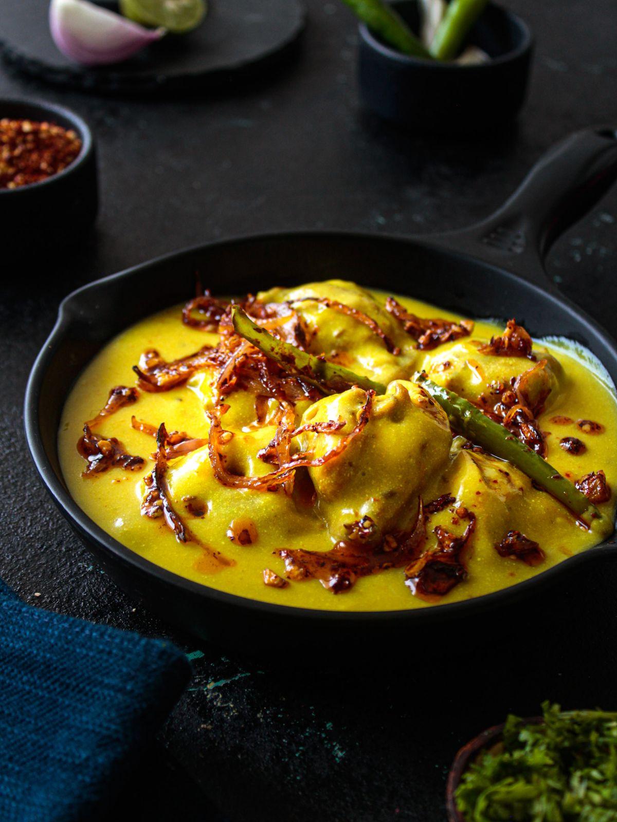Kadhi ready to eat garnished with freshly chopped coriander.