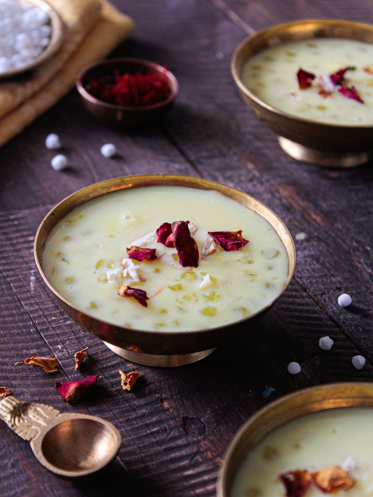 Sabudana Kheer ready to eat served in golden bowl and garnished with safron and dry rose petals