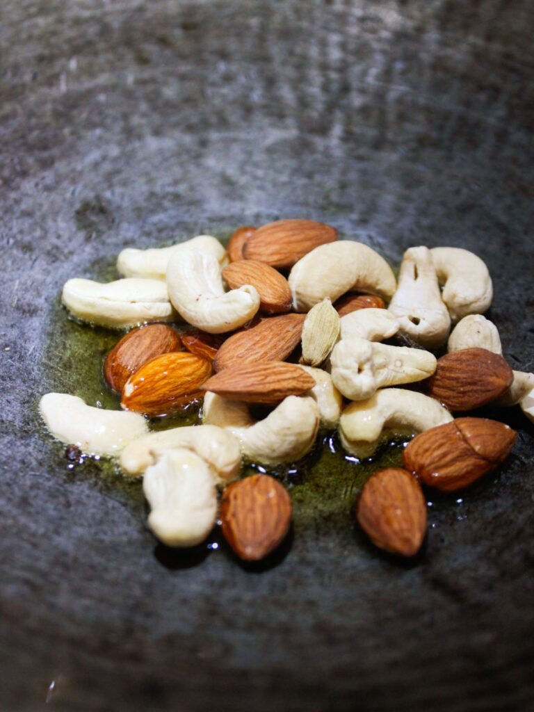 Cashews and almonds in ghee in skillet