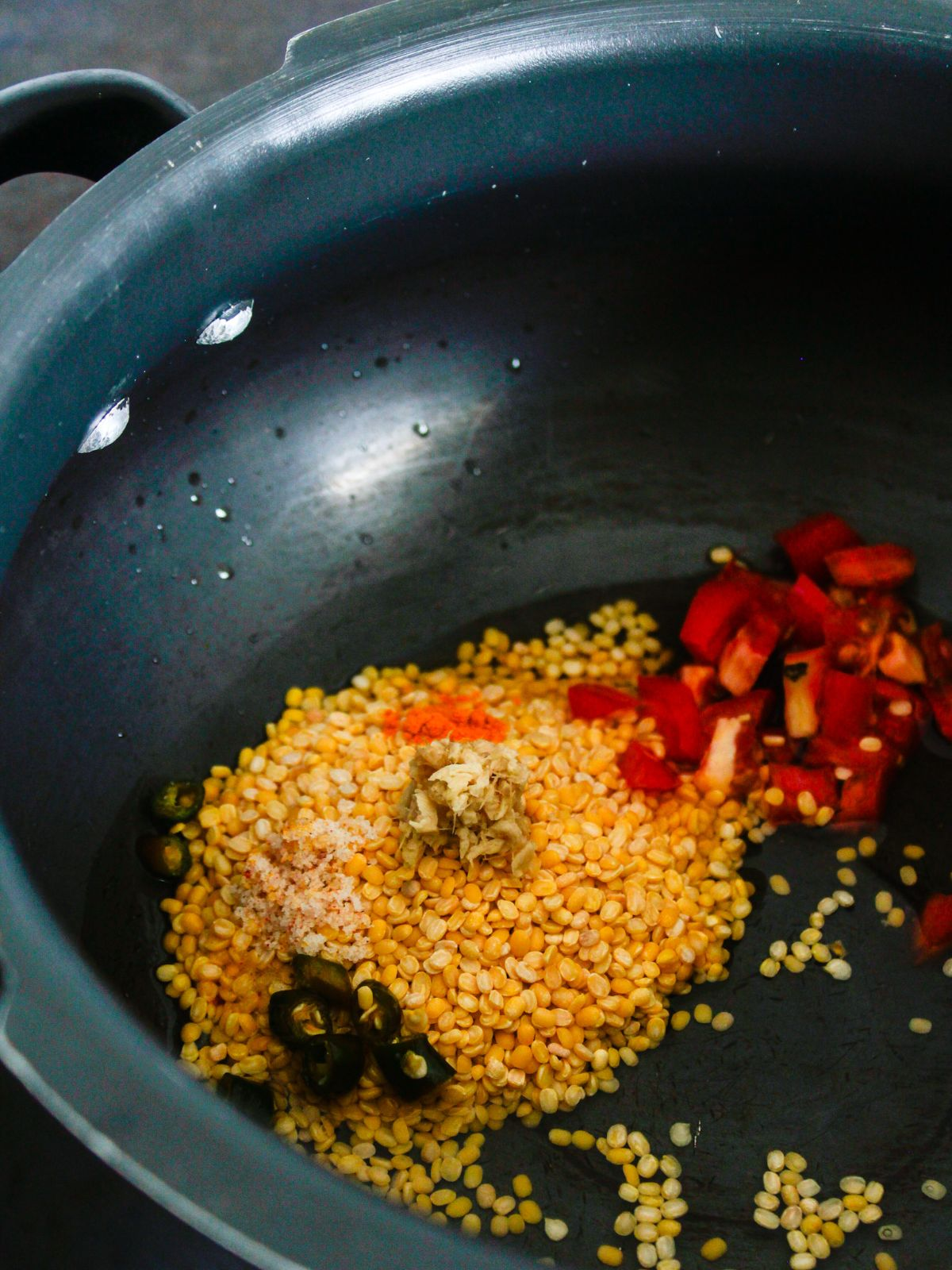 Yellow lentils and tomatoes with spices in pressure cooker