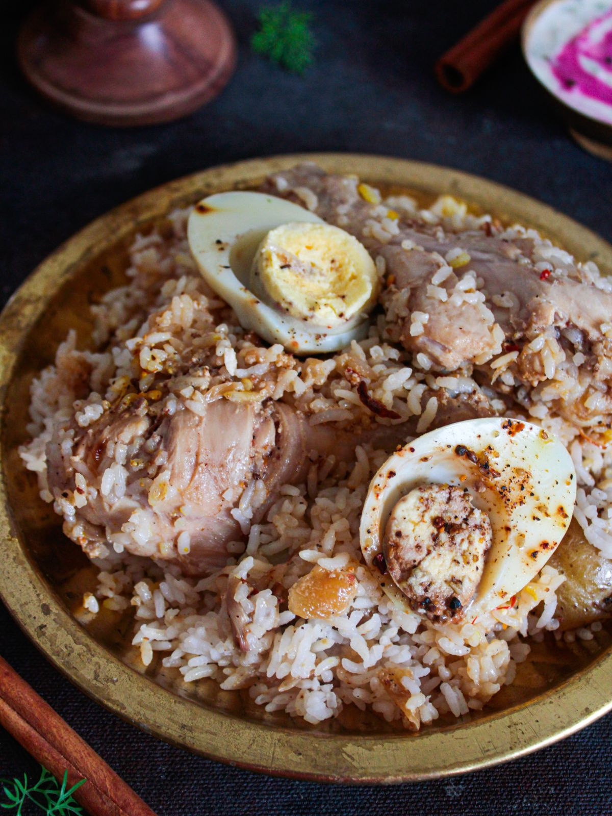 birayni with chicke egg and potato in gold bowl