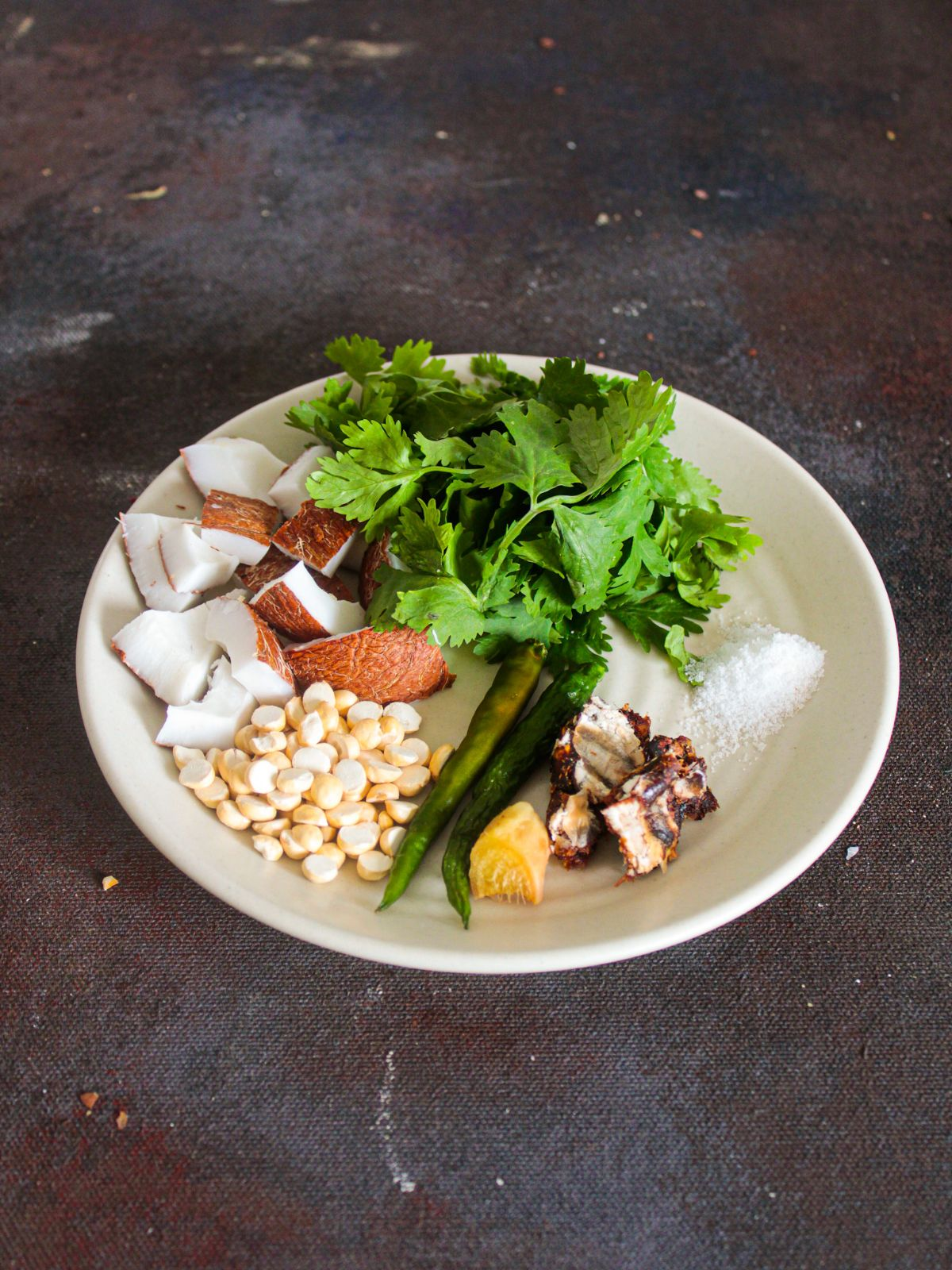 Ingredients for Coconut Coriander Chutney on white plate