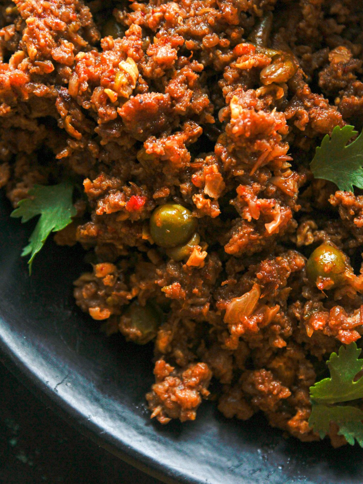 Black plate of ground meat keema