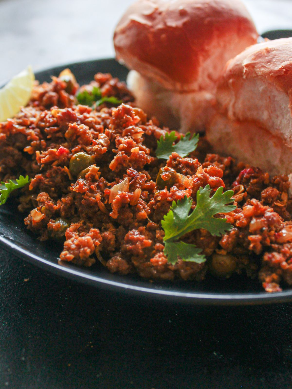mutton keema on plate with rolls