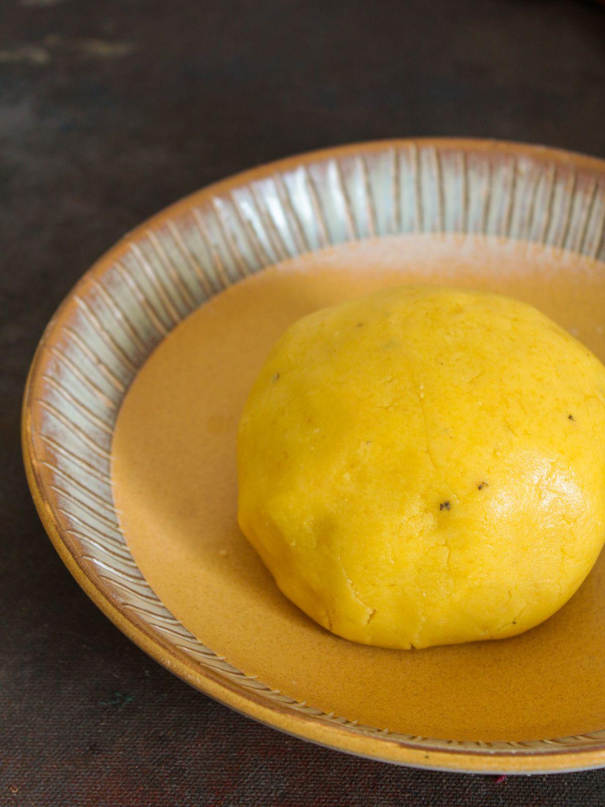 Ball of dough in cream bowl