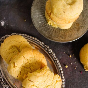 Stack of Naankhatai cookies on silver platter