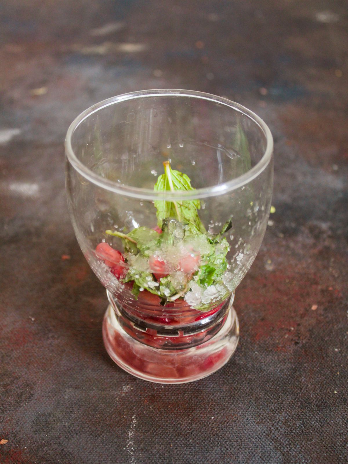 Glass of mint and pomegranate on table
