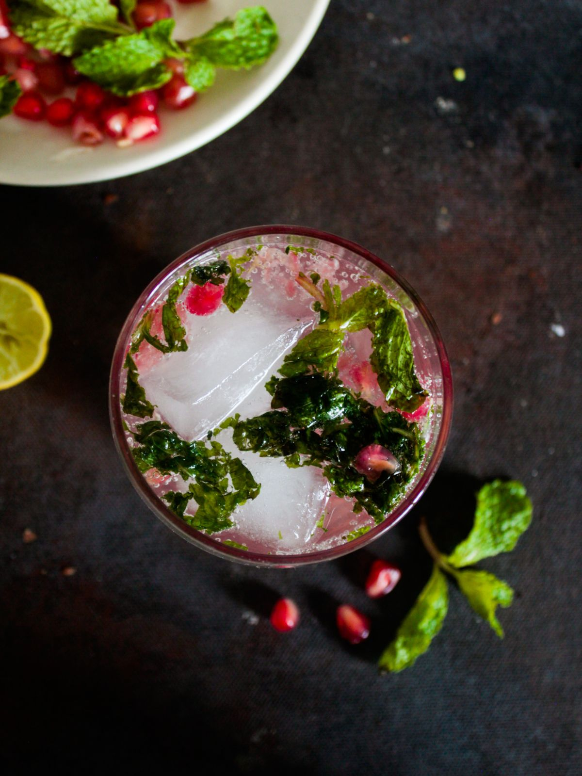 Image looking down at top of glass with mint and pomegranates