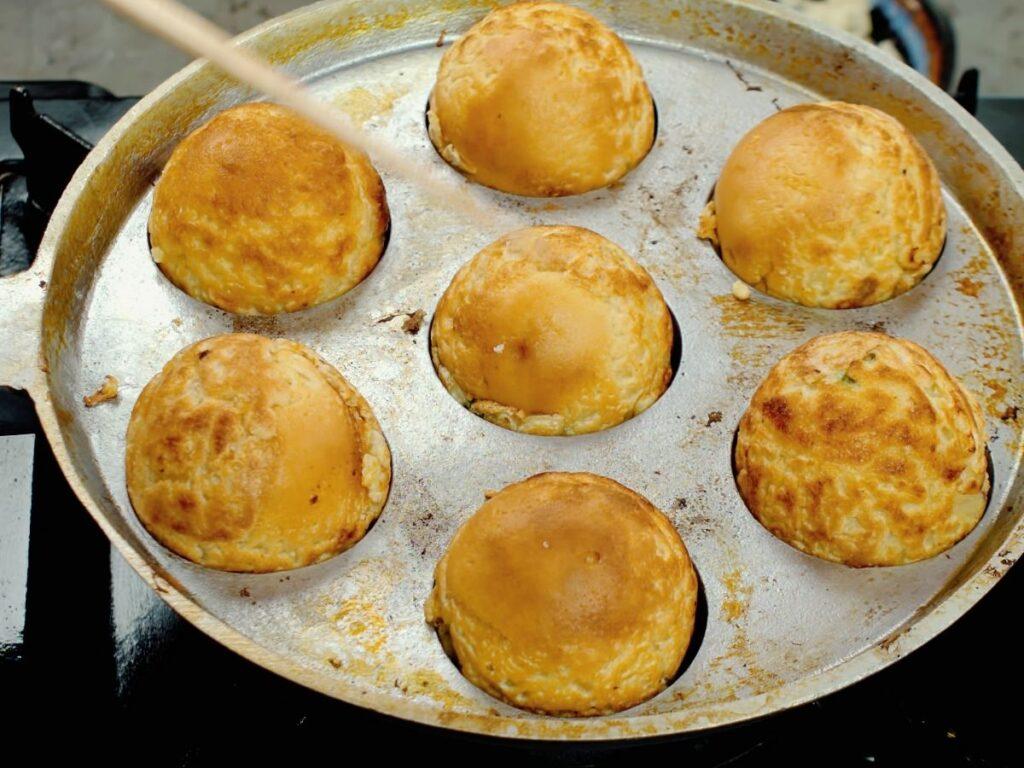 takoyaki balls being removed from pan